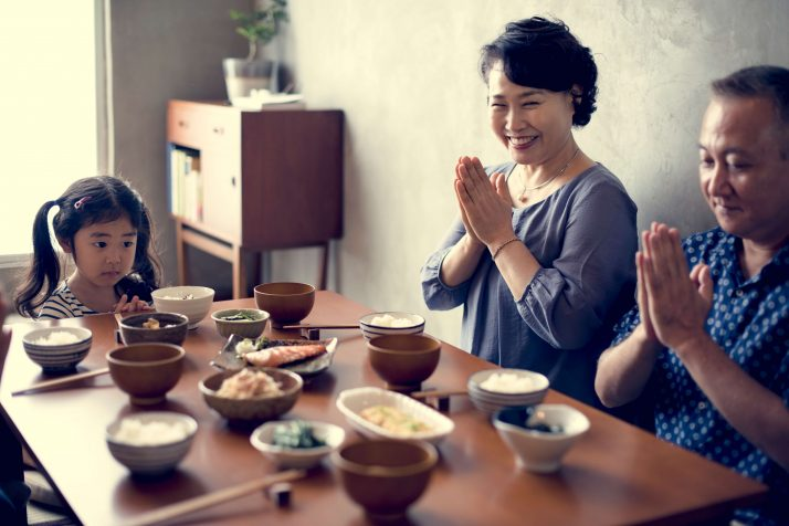 Japanese family praying together