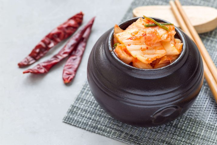 Kimchi cabbage. Korean appetizer in a ceramic jar, horizontal