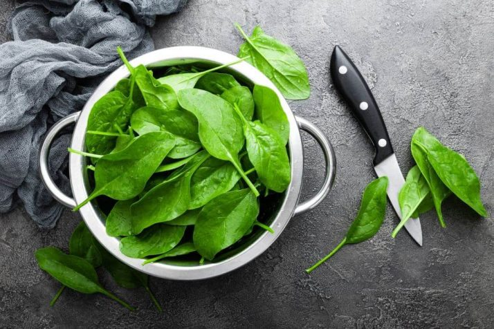 17 Surprising Spinach Nutrition Facts & Health Benefits; spinach leaves & knife