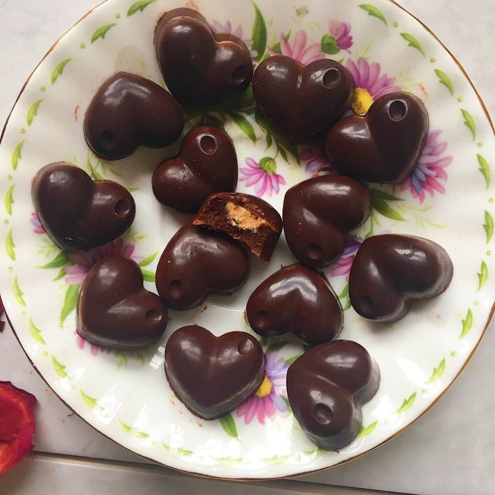 37 Healthy Valentine's Day Recipes: Indulge Without The Bulge CHOCOLATES WITH A PEANUT BUTTER CENTRE heart-shaped chocolates on a plate