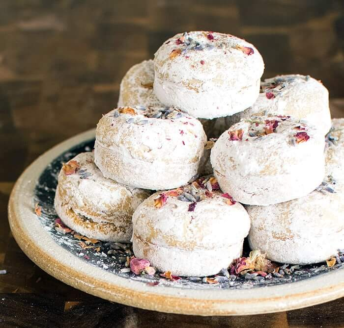37 Healthy Valentine's Day Recipes: Indulge Without The Bulge LAVENDER ROSE BAKED DONUTS white donuts stacked on a platter