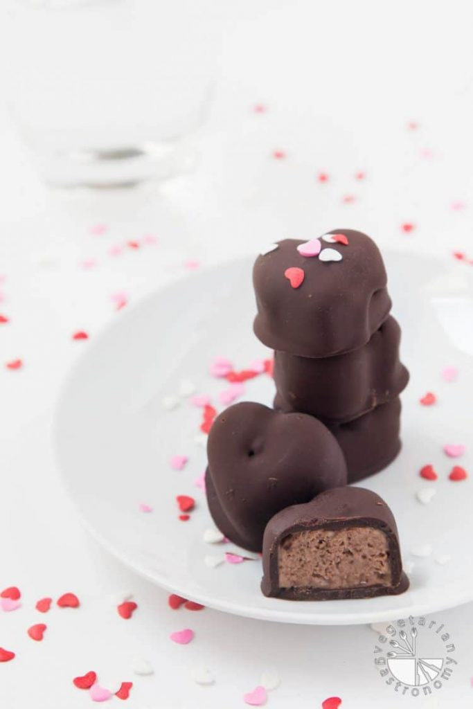 37 Healthy Valentine's Day Recipes: Indulge Without The Bulge CHOCOLATE COVERED BANANA-CHOCOLATE ICE CREAM BITES (VEGAN) Heart shaped chocolates on a plate