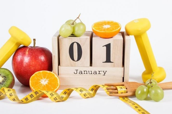 How Much Weight Can You Lose In A Month? (Truthfully) Cube calendar with date, fruits, dumbbells and tape measure