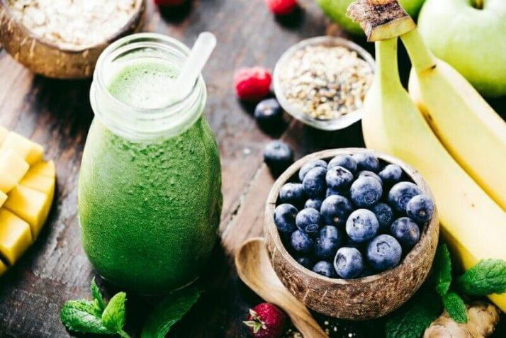 How To Lose Water Weight - 14 Ways To Reduce The Bloat  green smoothie berries fruits seeds