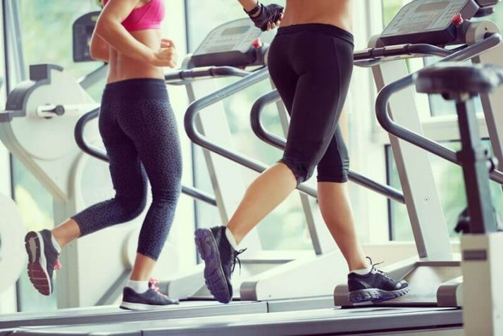 How Much Weight Can You Lose In A Month? (Truthfully) women exercising on treadmill in gym