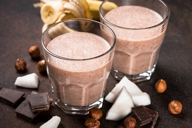 Chocolate banana coconut hazelnut milkshake or smoothie. Healthy organic drink.