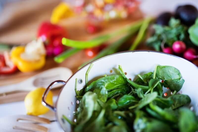 17 Surprising Spinach Nutrition Facts & Health Benefits; Fresh vegetables on the table, spinach & peppers