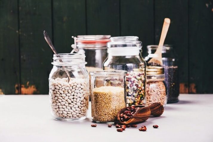Paleo vs Vegan? Why A Pegan Diet Is Your Best Option; Glass jars with various legumes and grains