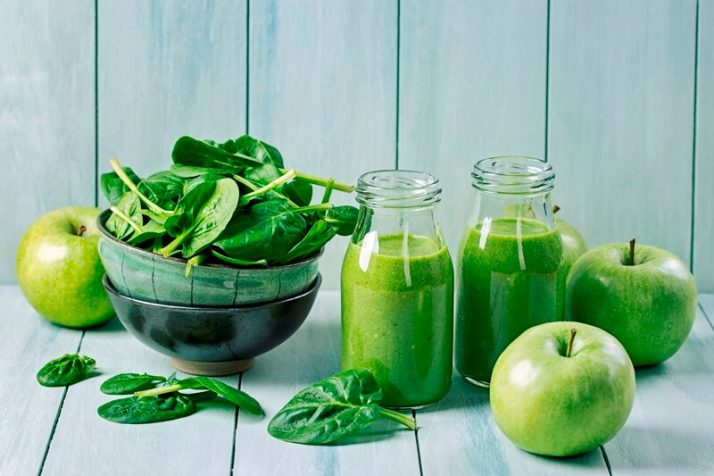 17 Surprising Spinach Nutrition Facts & Health Benefits; Green smoothie with spinach and apples