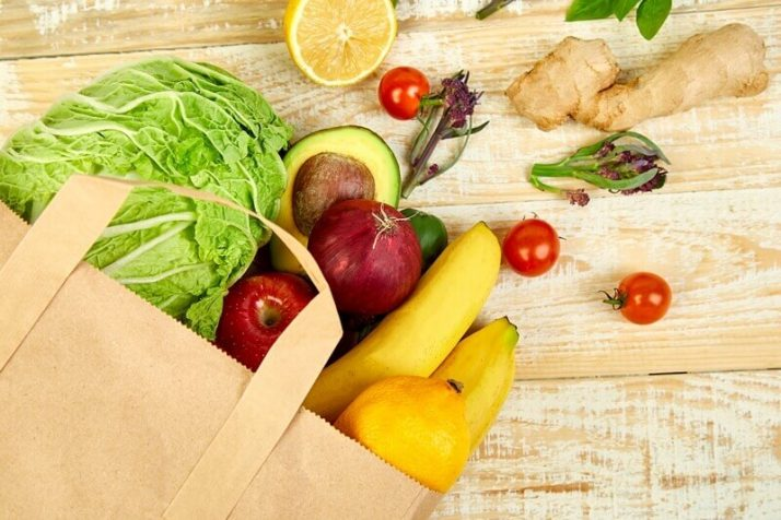 Paleo vs Vegan? Why A Pegan Diet Is Your Best Option; Grocery Full paper bag of different fruits and vegetables, vegan