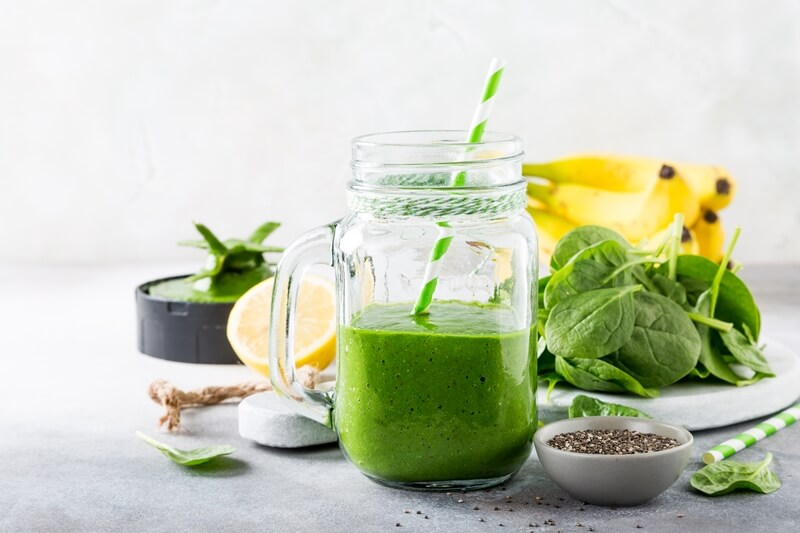 17 Surprising Spinach Nutrition Facts & Health Benefits; Healthy green smoothie with spinach in glass jar 2