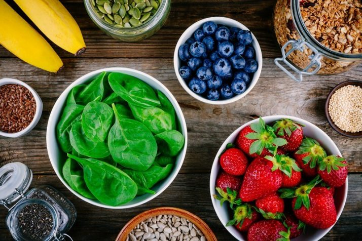 How To Use Spinach In A Smoothie: All Your Questions Answered; Ingredients-for-green-spinach-smoothies-strawberries-bananas-blueberries-seeds