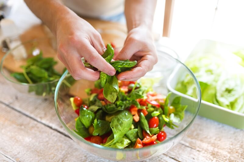 17 Surprising Spinach Nutrition Facts & Health Benefits; Ingredients for salad man holding spinach