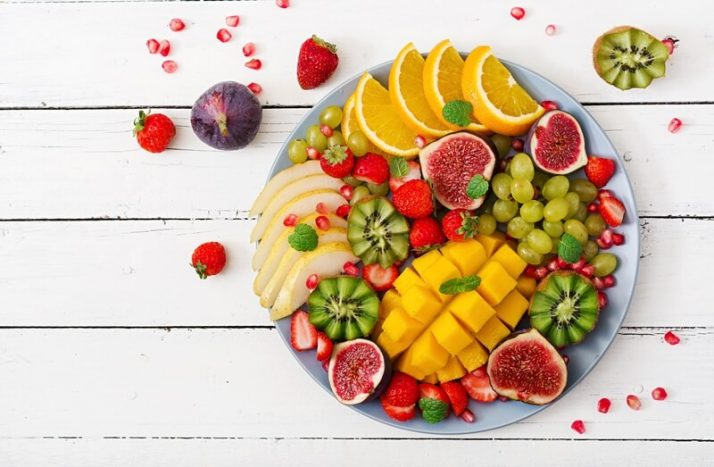 Paleo vs Vegan? Why A Pegan Diet Is Your Best Option; Platter fruits and berries, kiwis, mango, figs, berries, grapes, citrus