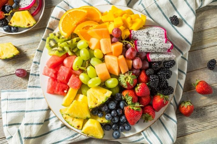 Paleo vs Vegan? Why A Pegan Diet Is Your Best Option; Raw Organic Fruit Platter salad, dragonfruit, berries, grapes, kiwis, watermlon