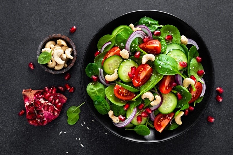 17 Surprising Spinach Nutrition Facts & Health Benefits; Spinach salad with vegetables and nuts