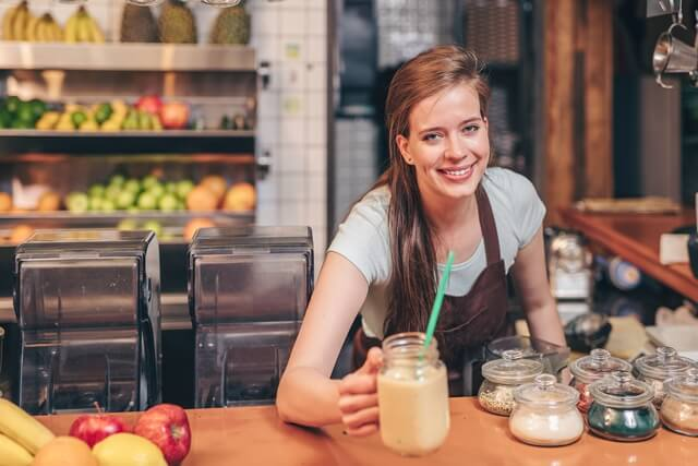 The Ugly TRUTH About Meal Replacement Shakes; Young chef with smoothies