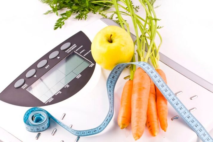 How Many Calories Should I Eat To Lose Weight FAST? carrots, apple and measuring objects scale tape weight loss