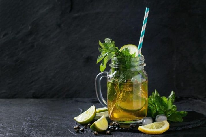 9 Weight Loss Drinks That Work Wonders Ice green tea in a jar with mint and lemon slices