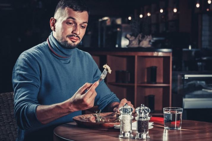 Paleo vs Vegan? Why A Pegan Diet Is Your Best Option; man at restaurant eating