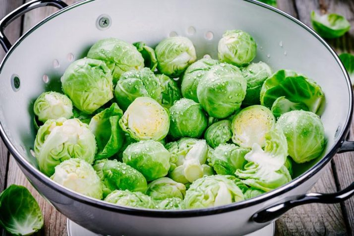 19 Best Plant Based Protein Sources: Complete Whole Foods; Fresh organic Brussels sprouts in a colander on a wooden table