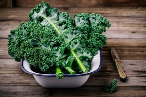 34 High Protein Vegetables You Probably Already Eat; Fresh raw green superfood kale curly cabbage leaves