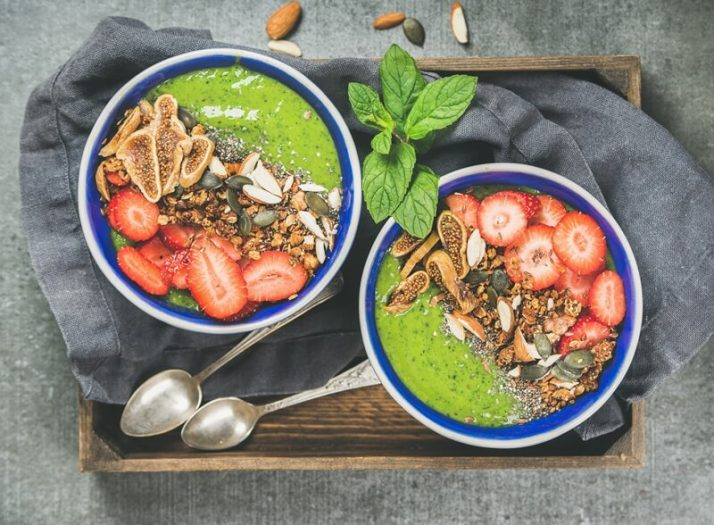 15 Green Smoothies For Weight Loss: Tasty, Fast & Healthy; Healthy green smoothie breakfast bowls with granola, fruit, seeds, berries