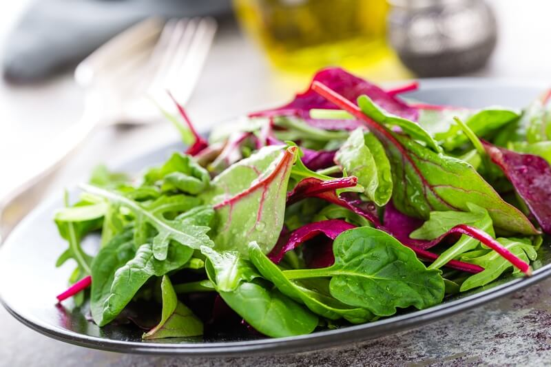 34 High Protein Vegetables You Probably Already Eat; Healthy vegetarian dish, leafy salad with fresh chard, arugula, spinach and lettuce. Italian mix