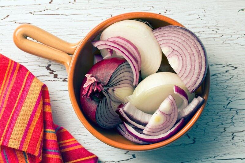 34 High Protein Vegetables You Probably Already Eat; chopped onions