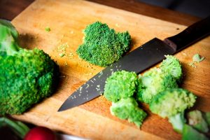 34 High Protein Vegetables You Probably Already Eat; cut fresh broccoli on cutboard