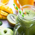 green smoothie in mason jar, mango apple kiwi