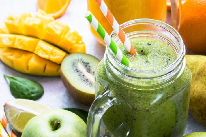 The 4 Green Smoothie Recipes Celebrities Drink To Stay Slim; green smoothie in mason jar, mango apple kiwi