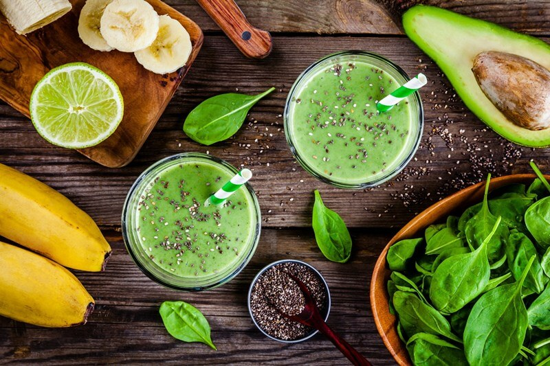 17 Surprising Spinach Nutrition Facts & Health Benefits;  healthy green smoothie with banana, lime, spinach, avocado and chia seeds