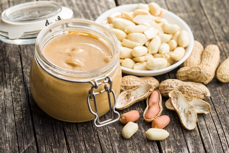 200+ Smoothie Ingredients Shopping List Printable; Peanut butter in jar and peanuts