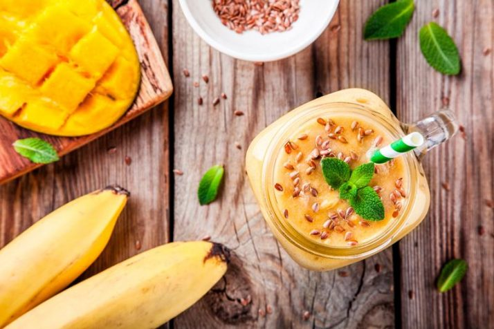 tropical smoothie made with mango, banana, flaxseed and mint