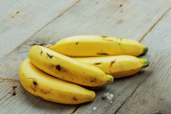 Complete Guide To Bananas: Facts, Benefits, Tutorials, Recipes & Videos; Banana of ripe on wood