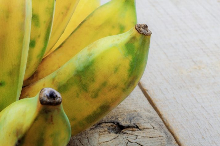 Complete Guide To Bananas: Facts, Benefits, Tutorials, Recipes & Videos; Banana on wood