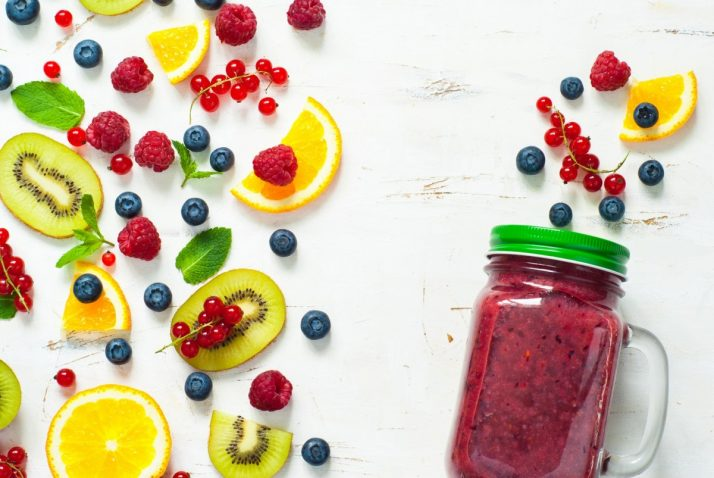 Complete Guide To Smoothies: 200+ Recipes, Diets, Tutorials & Videos; Fresh summer berries and fruits on white