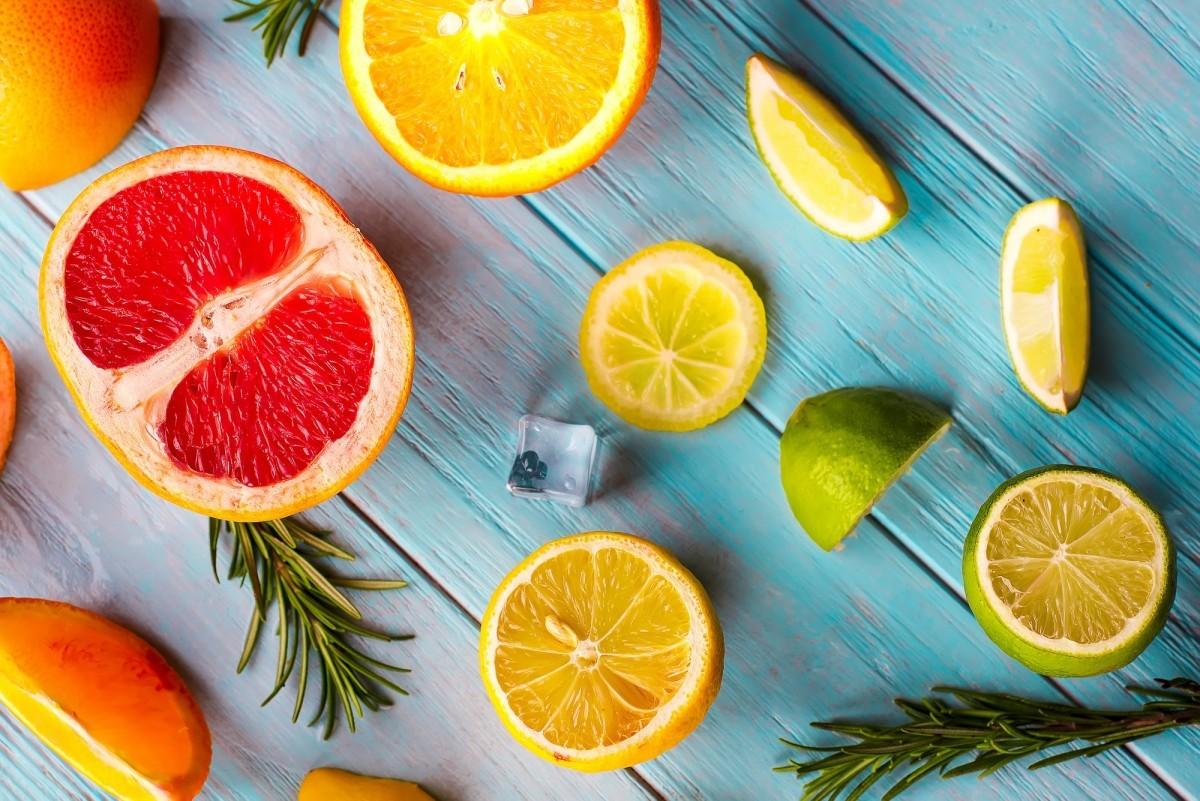 Pattern of slice citrus on blue wooden background