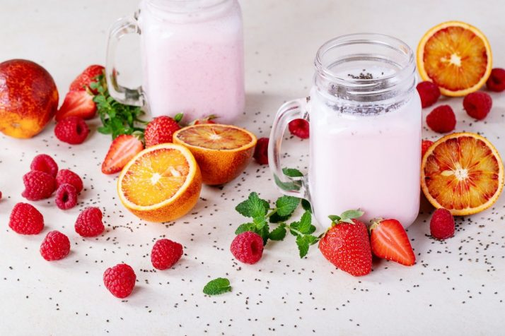 Complete Guide To Smoothies: 200+ Recipes, Diets, Tutorials & Videos; Strawberry smoothie in glass jars