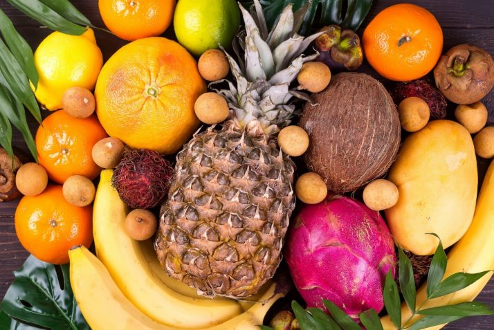 Guide To Fruit: Facts, Benefits, Tutorials, Recipes & Videos; Tropical fruits background, many colorful ripe tropical fruits