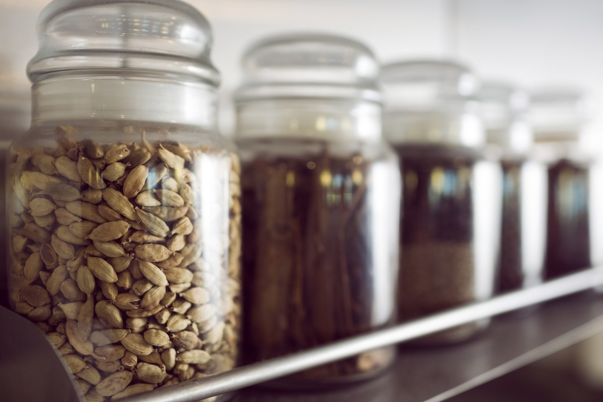 16 Best Smoothie Storage Solutions: My Smoothie Station Ideas; Closeup of assorted spices in bottles on shelf