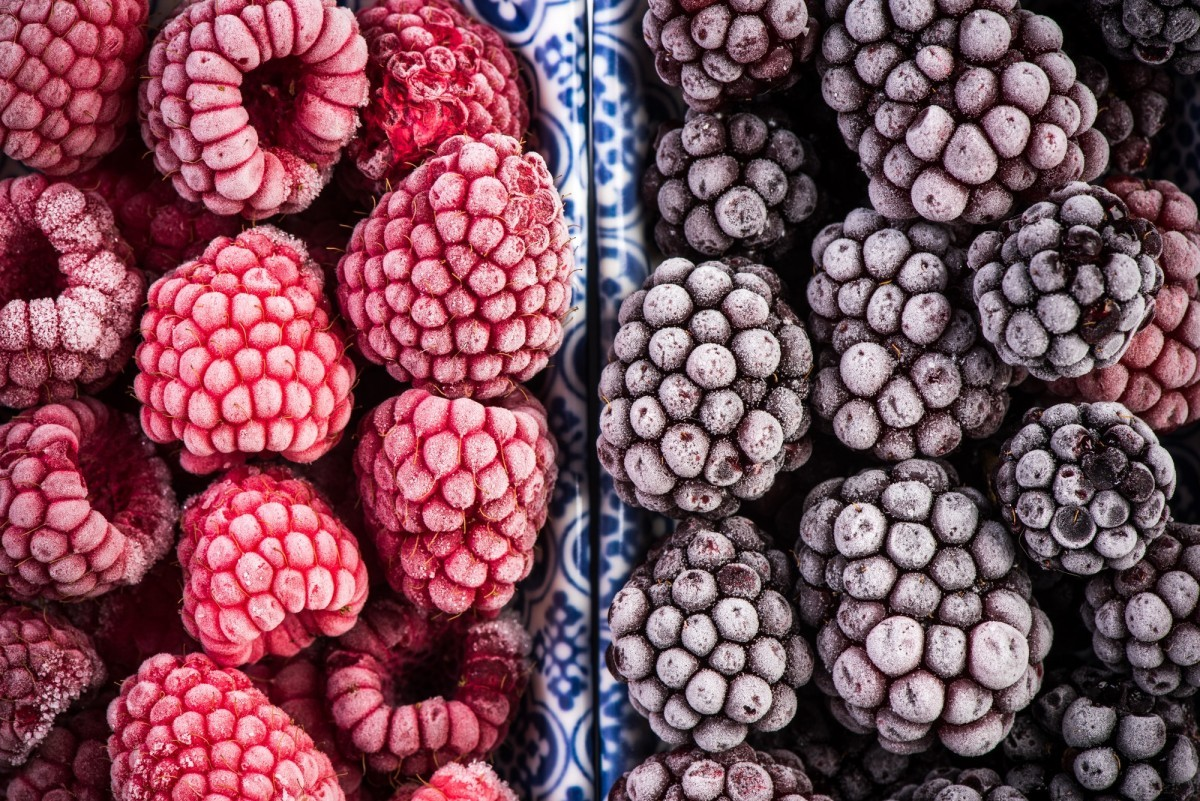 16 Best Smoothie Storage Solutions: My Smoothie Station Ideas; Frozen blackberry and raspberry fruits, close up