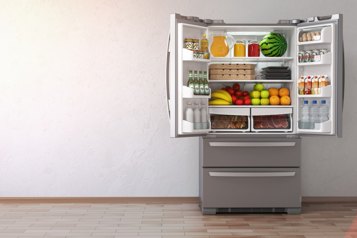 16 Best Smoothie Storage Solutions: My Smoothie Station Ideas; Open fridge refrigerator full of food in the empty kitchen inte