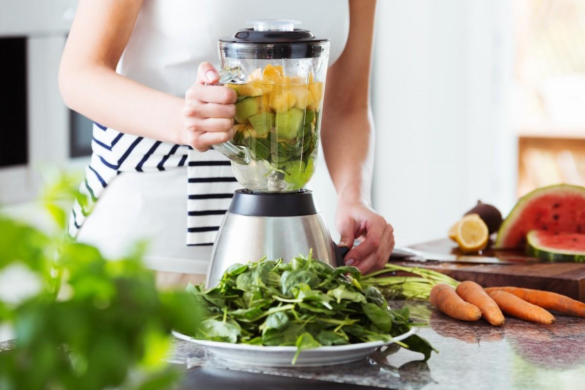 96 Vegan & Gluten Free Blender Recipes; Vegetarian preparing vegan smoothie