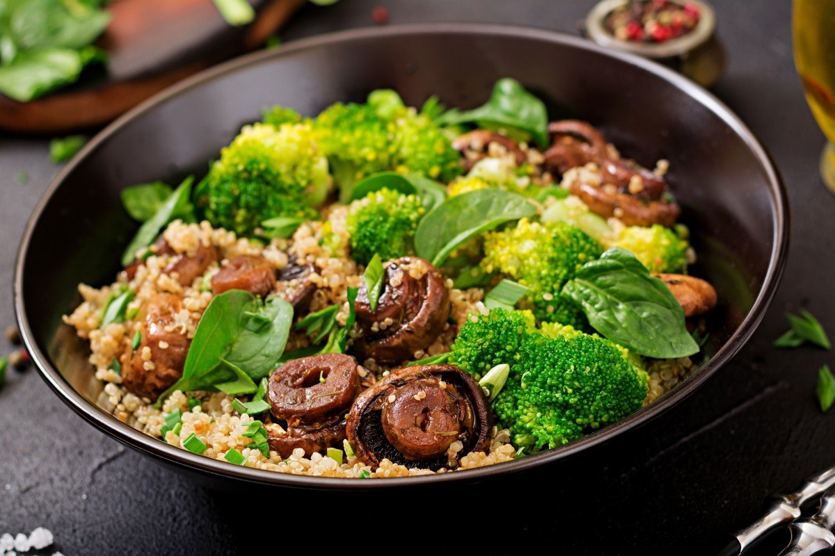 3 Vegetables That Provide ALL Your Essential Nutrients (With Only 450 Calories); Dietary menu. Healthy vegan salad of vegetables - broccoli, mushrooms, spinach and quinoa in a bowl