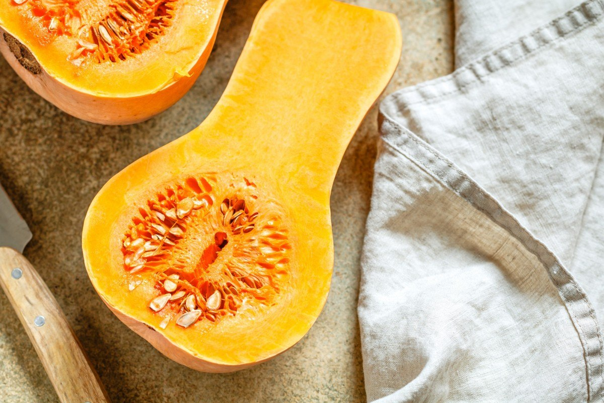 35 Best Smoothie Ingredients For Weight Loss (List & Recipes); View on raw halves of butternut squash on a kitchen table. Seasonal vegetable food, still life.